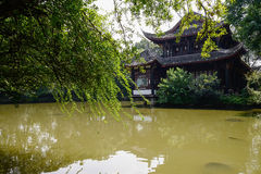 Ancient Chinese building in lake on sunny summer day Royalty Free Stock Photo