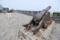 Ancient Chinese cannon. In the ancient city wall royalty free stock photos