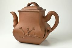 Ancient Chinese clay brewing teapot. On a white background Stock Image