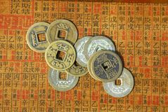 Ancient Chinese coins on a text back Stock Images