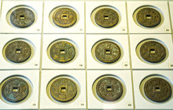 The ancient Chinese coins of the various dynasties in the museum. Are preserved today Stock Photo