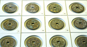 The ancient Chinese coins of the various dynasties in the museum. Are preserved today Royalty Free Stock Image