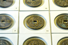 The ancient Chinese coins of the various dynasties in the museum. Are preserved today Stock Photography