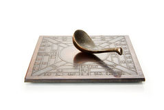 Ancient Chinese compass on white Stock Photo