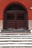 Ancient chinese door in winter. Ancient chinese door on a snowy day Stock Photo