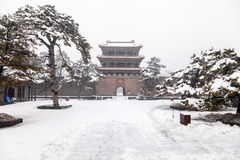 Ancient chinese door in winter. Ancient chinese door on a snowy day Stock Photography