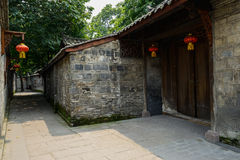 Ancient Chinese dwelling house with lanterns in narrow alley Stock Photo