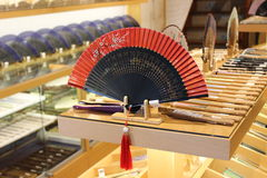 The ancient Chinese folding fan was placed on the counter. Stock Photo