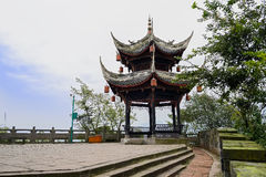 Ancient Chinese gazebo on mountaintop viewing platform in cloudy Royalty Free Stock Photo