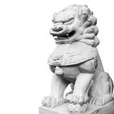 Ancient Chinese lion statue made of gray stone isolated Royalty Free Stock Photography