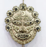 Ancient chinese manual shamanistic mask. Shamanism is a folk belief activities developed on the basis of the original faith. Spread in the northeast to the Stock Images