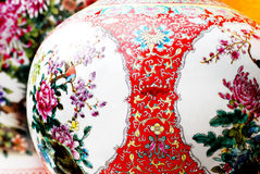 Ancient chinese porcelain. Ancient chinese ball-shaped porcelain vase on display,colorful flower patterns of chrysanthemum,traditional chinese paintings of peony Stock Photography