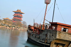 Ancient Chinese ship and building. An ancient Chinese ship on the frozen lake and an ancient Chinese building Royalty Free Stock Photos