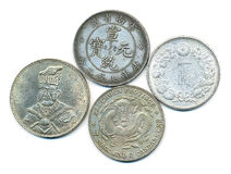 Ancient chinese silver. Coins isolated on white Stock Photos