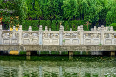 The ancient Chinese stone bridge in garden Stock Image