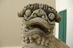 Ancient Chinese stone lion carved by hand Royalty Free Stock Image