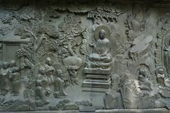 Ancient chinese stone relief .marble sculpture.carved trees, mountain,person. Ancient chinese stone relief .marble sculpture.carved trees, mountain,ancient royalty free stock photo