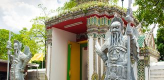 Ancient Chinese warrior Demon stone statuesat Wat Pho Royalty Free Stock Images