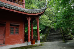 Ancient Chinese wood-structure building in woods Stock Photos
