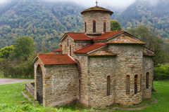Ancient Christian Church Caucasus. Ancient X century christian church made of stones near Arkhyz Caucasus region surrounded by a wild nature and mountains Stock Image