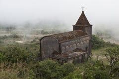 Ancient Christian church. Kampot, Cambodia. Abandoned ancient Christian church fog enveloped. Kampot, Cambodia Stock Images