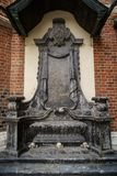 Ancient gothic church of Saint Mary in Krakow. Ancient Christian church of Saint Mary from Krakow city in Poland built in gothic style.Marble stone skull statue royalty free stock images