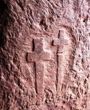 ancient Christian cross on church wall Stock Photos