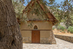 Ancient Christian Orthodox church of Archangelos Michael at Gala. Ancient Christian Orthodox church of Archangelos Michael behind olive tree at the village of Royalty Free Stock Image