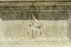 Ancient christian relief. Showing cardinal with a text - quirinus sanctus -  only remnants of the original sign Stock Photography