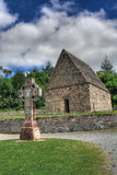 Ancient church. And cross in the Irish Heritage Museum in Ireland stock photography