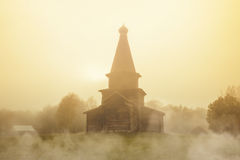 Ancient Church of the Assumption. Museum of wooden architecture Vitoslavitsy. Ancient Church of the Assumption in the fog. Museum of wooden architecture Stock Images