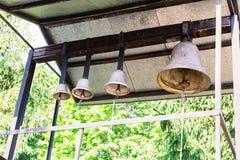 Ancient church bells on an iron fastener. Ancient church bells on an iron fastener stock photo