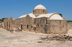 Ancient Church. The building of the ancient church surrounded by a dilapidated wall with arches Royalty Free Stock Photo