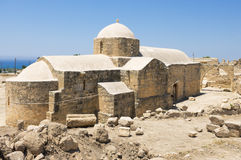 Ancient Church. The building of the ancient church surrounded by a dilapidated wall with arches Royalty Free Stock Photography