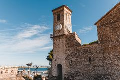 Ancient church with clock tower at old european city,. Cannes, France royalty free stock photos
