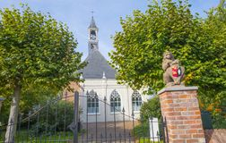 Ancient church in a dutch village in fall colors in autumn in sunlight. In autumn stock photos