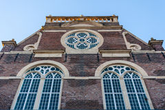 Ancient church facade in Amsterdam. Church facade in Amsterdam with rose window Royalty Free Stock Photography