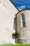 Ancient church facade with stained-glass window Stock Image