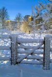 Ancient church and gate. In the snow, deep in winter Stock Photography