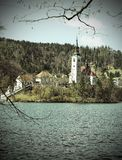 Ancient church with a high Bell Tower on the island on Lake Bled Stock Images