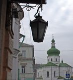Ancient church and lantern in Kyiv. Ancient church and a lantern in the old Podil district in Kyiv, Ukraine Royalty Free Stock Photos