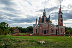 Ancient church. A large ancient church with towers in the background of beautiful clouds Royalty Free Stock Images