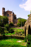 Ancient church and medieval bridge in Sant Joan les Fonts. Catalonia, Spain Royalty Free Stock Photography
