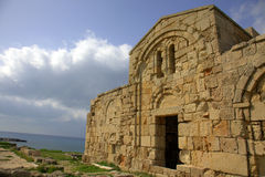 Ancient church on the Mediterranean coast Stock Photos