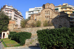Ancient Church in the Modern City. Orthodox church of Aghios Panteleimon in Thessaloniki, Northern Greece. The Ancient church is situated between modern Royalty Free Stock Photo