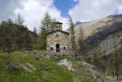 Ancient church in mountains Stock Image