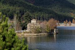 Ancient church Saint Fanourios on the Lake Doxa Greece, region Corinthia, Peloponnese on a autumn, sunny day.  royalty free stock photos