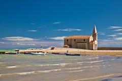 Ancient church on seacoast. In Italy Stock Photos