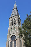 Ancient church tower against blue sky, Riel, Netherlands Stock Image