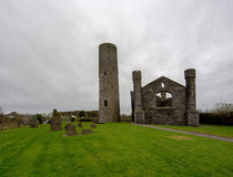 Ancient church and tower in Ireland Stock Photos